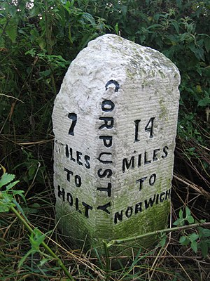 B1149 road - Image: Milestone in the hedge near Corpusty, on B1149 Holt Road