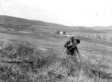 Milton Manaki filming with Bioscope Camera 300 in a valley