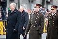 Ministru prezidents Valdis Dombrovskis vēro Nacionālo bruņoto spēku vienību militāro parādi 11.novembra krastmalā (6357752825).jpg