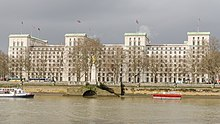 The east elevation of the building with the River Thames in the foreground.