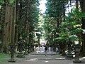 Monks walk through the approach of Northern Fuji Sengen Shrine.JPG