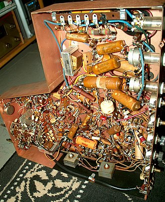 """Point-to-point construction - Underside of the chassis of a 1948 Motorola VT-71 7"""" television, showing the complexity of the point to point wiring."""
