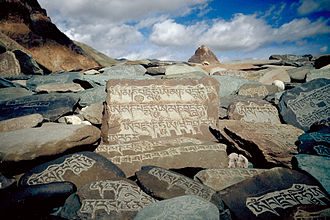 "Om mani padme hum - Carved stone tablets, each with the inscription ""Om Mani Padme Hum"" along the paths of Zangskar"