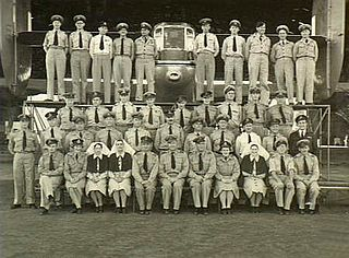 Three rows of uniformed men and women in group portrait