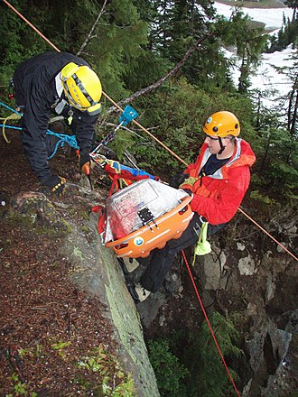Mount Seymour Provincial Park - North Shore Rescue members perform a rescue training exercise on a vertical cliff.