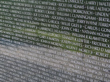 one panel of the wall displaying some of the names of fallen us service members from the vietnam war - Who Designed The Vietnam Wall