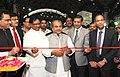 Narendra Singh Tomar lighting the lamp inaugurating the 'Steel Pavilion' in IITF-2014, at Pragati Maidan, in New Delhi. The Minister of State for Mines and Steel, Shri Vishnu Deo Sai and the Secretary.jpg