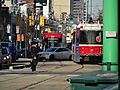 New streetcar 4404 passes old CLRVs, 2014 12 20 (2) (15886993747).jpg