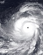 A visible image of Super Typhoon Nida, depicting a symmetrical storm and a clear eye, both of which are hallmarks of a powerful tropical cyclone.