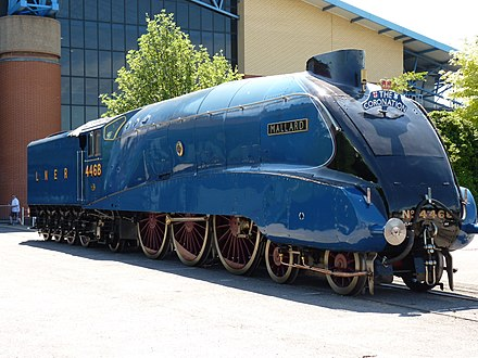 The LNER Class A4 4468 Mallard built in Doncaster is the current confirmed record holder as the fastest steam locomotive at 203 km/h (126 mph) on 3 July 1938. Number 4468 Mallard in York.jpg