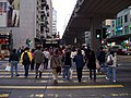 Pedestrians cross road in Mong Kok.jpg