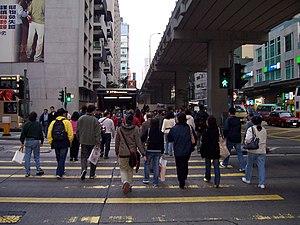 Pedestrians cross road in Mong Kok