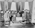 Photograph of President Truman in the Oval Office, receiving a report on the accomplishments of the Boy Scouts from a... - NARA - 200268.tif