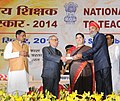 Pranab Mukherjee presenting the National Award for Teachers-2014 to Shri Shaitan Singh Ranavat, Rajasthan, on the occasion of the 'Teachers Day', in New Delhi. The Union Minister for Human Resource Development.jpg