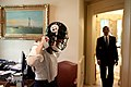President Barack Obama watches his personal secretary, Katie Johnson, try on a Pittsburgh Steelers football helmet outside the Oval Office, May 21, 2009.jpg