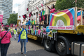Pride in London 2016 - The Amnesty International float and a steward in the parade.png