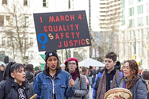 Protester holding sign at Women's March Rally in Vancouver (January 19, 2019).jpg