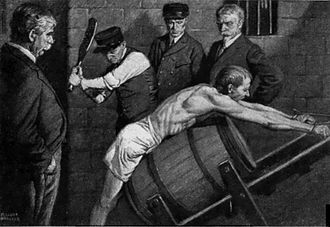 Paddle (spanking) - 1912 illustration of an inmate being punished in an American prison