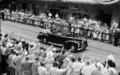 Queensland State Archives 1649 Her Majesty Queen Elizabeth II and HRH The Duke of Edinburgh waving to crowds Brisbane 12 March 1954.png