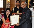 Ram Nath Kovind presenting the Nari Shakti Puruskar for the year 2017 to Dr. Malvika Iyer, Chennai, Tamil Nadu, at a function, on the occasion of the International Women's Day, at Rashtrapati Bhavan, in New Delhi.jpg