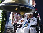 Ray Chavez, 104, the oldest living Pearl Harbor survivor, rings the Freedom Bell. (31111833980).jpg