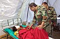 Review of patient by team of Army doctors during the rescue operation, at Lagankhel, in Nepal on May 01, 2015.jpg