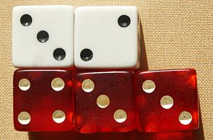Risk (game) - Example of matching up attacking (red) and defending (white) dice; in this dice roll, the defender loses two armies.