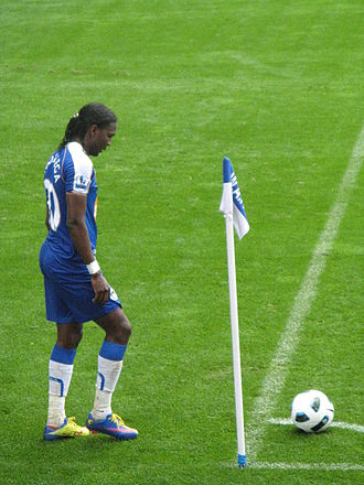 Glossary of association football terms - Chelsea player Didier Drogba standing by the corner flag, about to take a corner kick