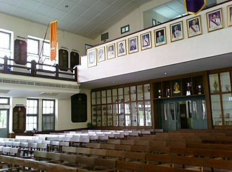 Triam Udom Suksa School - Room 111, with its display of trophies and name plaques honouring top graduates, King's Scholarship recipients and International Science Olympiad medallists