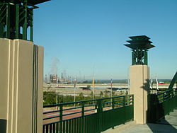Route 66 pedestrian overpass looking onto Cyrus Avery Plaza.jpg