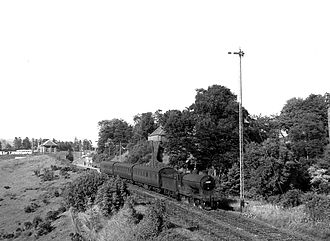 Devon Valley Railway - Locomotive number 62490 leaving Rumbling Bridge Station in 1957