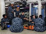 Sailors receive first aid training during a general quarters drill aboard USS Theodore Roosevelt. (30482834762).jpg