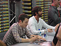 San Diego Comic-Con 2011 - Elijah Wood and Jason Gann from Wilfred sign for fans (Fox booth) (5976792425).jpg