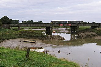 Sea Mills, Bristol - The remains of the dock wall and the Severn Beach line crossing the River Trym at Sea Mills