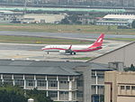 Shanghai Airlines B-5077 Taxiing at Songshan Airport Apron 20130421.jpg