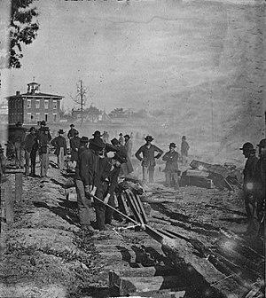 Sherman's March to the Sea - Sherman's men destroying a railroad in Atlanta.