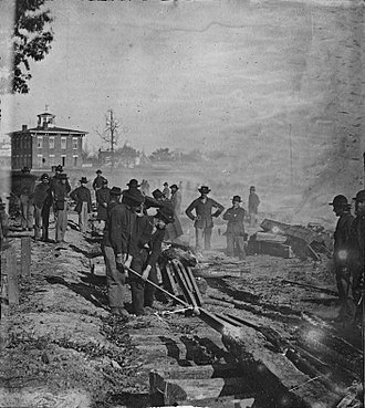 Sherman's March to the Sea - Sherman's men destroying a railroad in Atlanta.