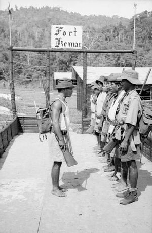 Senoi - Local guards from the Senoi tribe at Fort Kemar, one of a chain of posts in the heart of the central mountain range of Malaya, 1953.