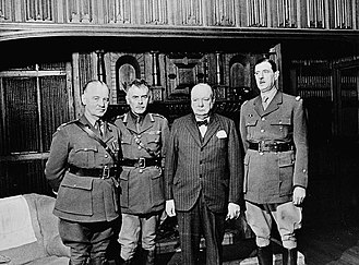 Charles de Gaulle (far right) with Andrew McNaughton, Wladyslaw Sikorski, and Winston Churchill Sikorski McNaughton Churchill de Gaulle C064027.jpg