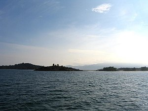 Lingga Islands - Many islands that are part of the Lingga archipelago, including the island of Lingga itself towards the right, with its 1163-metre fog-obscured peak.