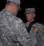 Soldiers assigned to Team Delta, Task Force 1-293rd Infantry Battalion receive awards DVIDS113567.jpg