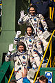 Soyuz TMA-06M crew members wave farewell.jpg