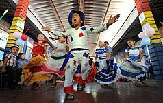 Students give a dancing performance during a closing ceremony at Escuela de Educacion Parvularia Maria Luisa Marcia in La Union, El Salvador, Feb 110224-N-EC642-303.jpg