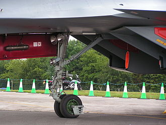 Sukhoi Su-30MKI - Nosewheel of a Su-30MKI; note the externally mounted drag brace is fixed to the fuselage instead of the gear leg