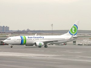 Sun Country Airlines - A Sun Country 737-800 on seasonal lease from Transavia, and wearing Transavia livery (with Sun Country titles), December 2015.