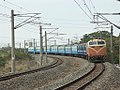 TRA E225 with Ordinary Express Train 20050108.jpg