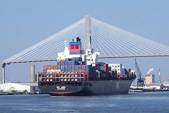 Talmadge Memorial Bridge - A ship passing under the bridge.
