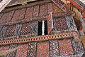 Tana Toraja, Palawa, painted front of a tongkonan (6823231508).jpg