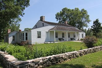 Built in 1776 by French-Canadian voyageur Joseph Roi, the Tank Cottage is the oldest standing building from the state's early years. Originally located on 8th Street along the Fox River, the cottage was moved to Heritage Hill State Historical Park in neighboring Allouez and is listed on the National Register of Historic Places. Tank Cottage Heritage Hill June 2014.jpg