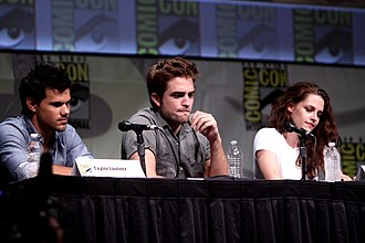 Kristen Stewart - Taylor Lautner, Robert Pattinson and Stewart at a media appearance